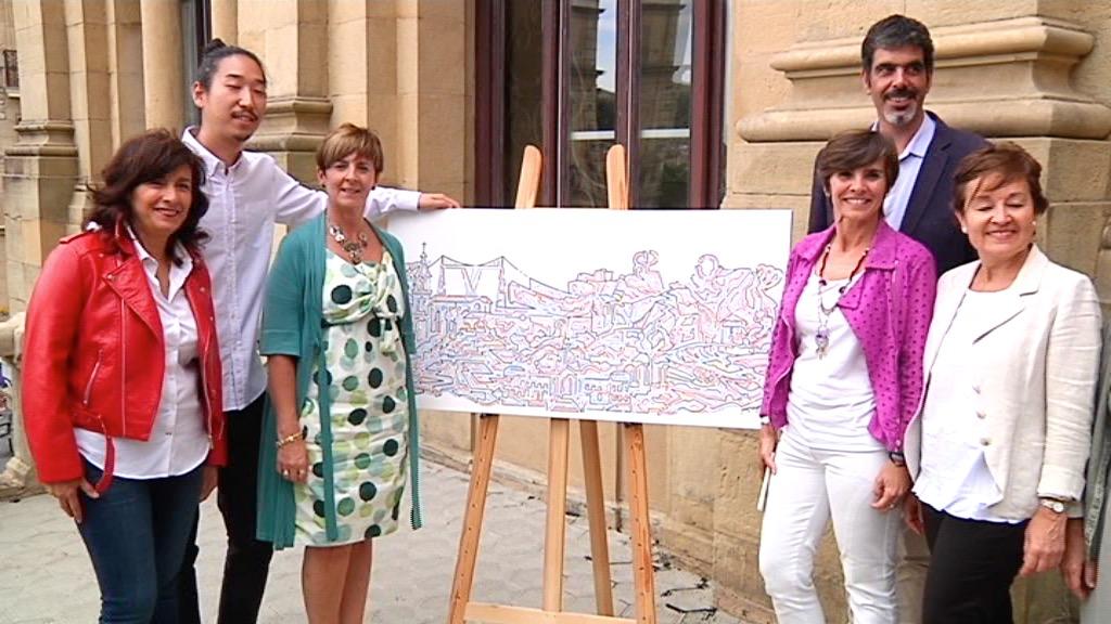 La consejera Tapia entrega al alcalde de Donostia el cuadro del 'skyline' de Euskadi